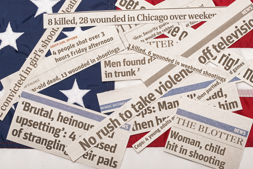 American Flag Buried In Violence Headlines