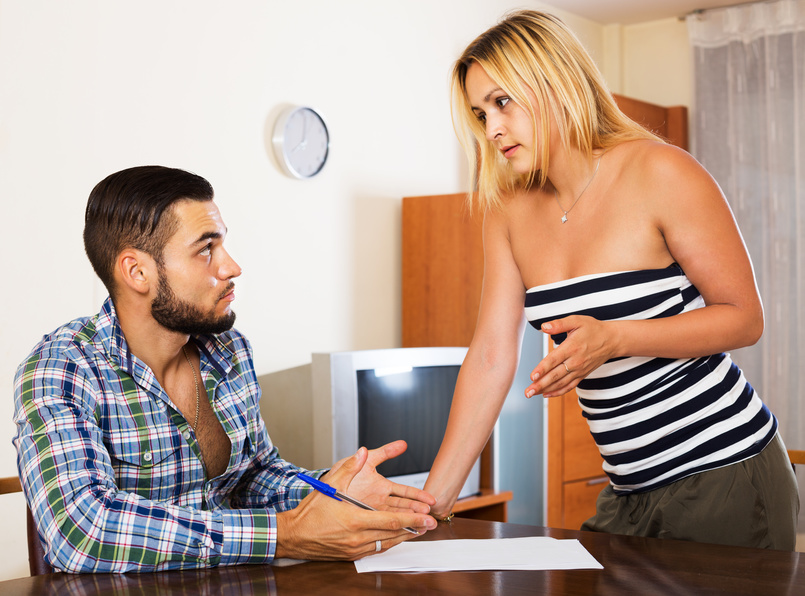 Problems with bank - couple discussing options in office interior. Focus on man