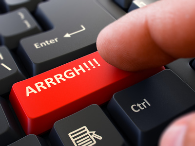 ARRRGH - Written on Red Keyboard Key. Male Hand Presses Button on Black PC Keyboard. Closeup View. Blurred Background.