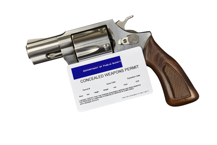 Gun with Concealed Weapon Permit Isolated on White