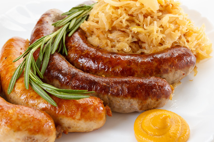 Traditional Octoberfest menu, plate of sausages and sauerkraut. Oktoberfest meal.